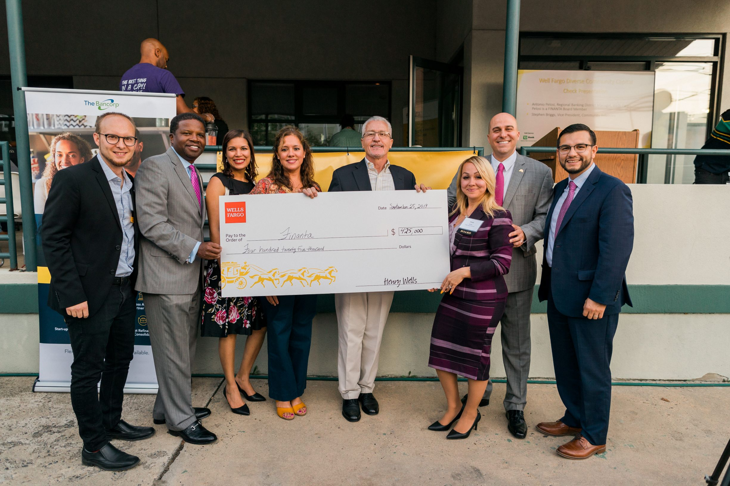 Wells Fargo check presentation to FINANTA